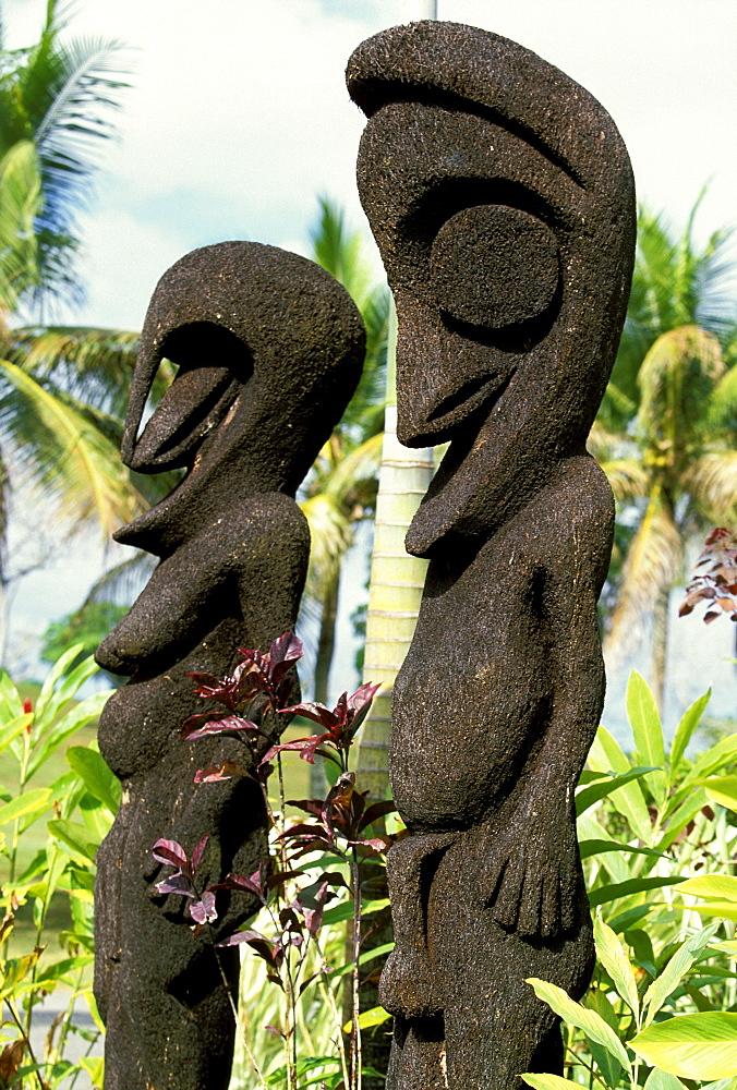 Male and female 'fern figures', traditional statues made from tree fern trunks, Efate Island, Port Vila, Vanuatu
