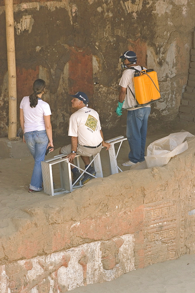 Preservation treatment of a mural by members of the National University of Trujillo team at this adobe brick temple pyramid of the Moche people (100BC-AD850) in the desert north, Huaca de la Luna, Trujillo, Peru, South America