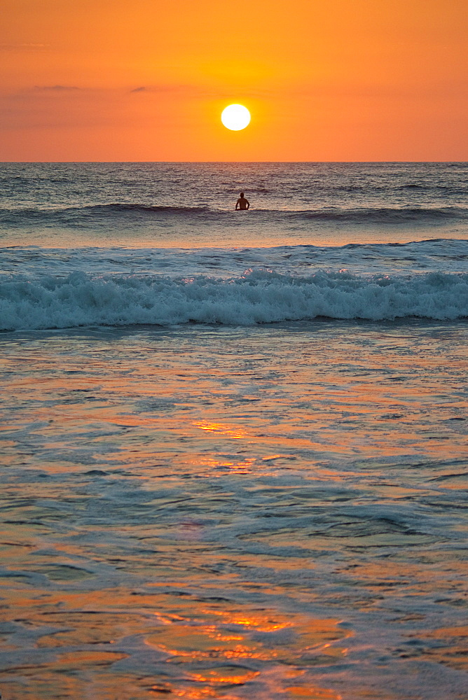 Sunset at Playa Guiones surfing beach, Nosara, Nicoya Peninsula, Guanacaste Province, Pacific coast, Costa Rica, Central America - 83-12592