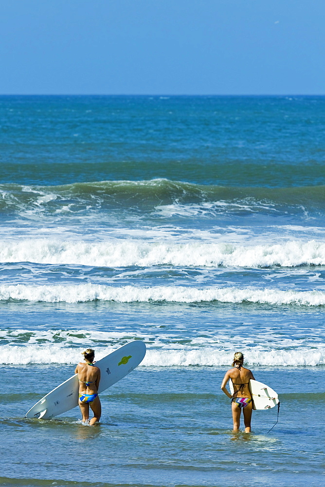 Girls surfing at popular Playa Guiones beach, Nosara, Nicoya Peninsula, Guanacaste Province, Costa Rica, Central America