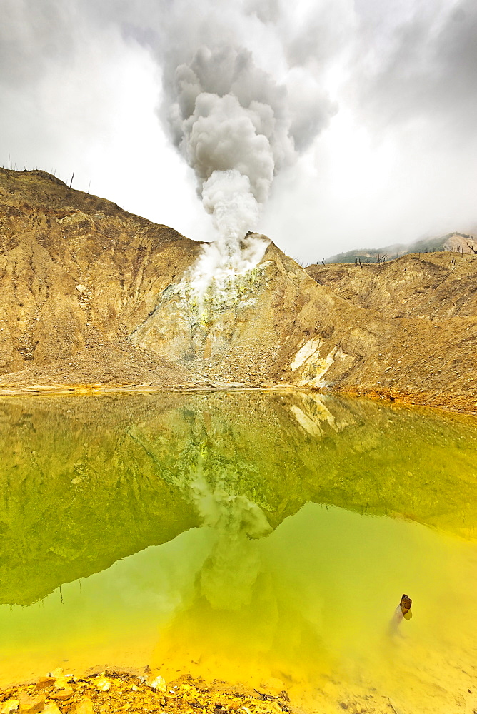 Green crater lake and steaming fumaroles at Papandayan Volcano, an active four cratered caldera, Garut, West Java, Java, Indonesia, Southeast Asia, Asia