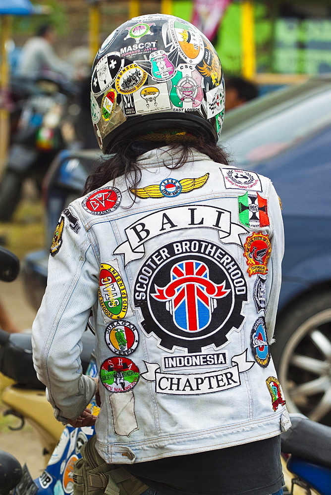 Man in jacket with patches at scooter enthusiast's meet in this south coast resort town, Pangandaran, West Java, Java, Indonesia, Southeast Asia, Asia