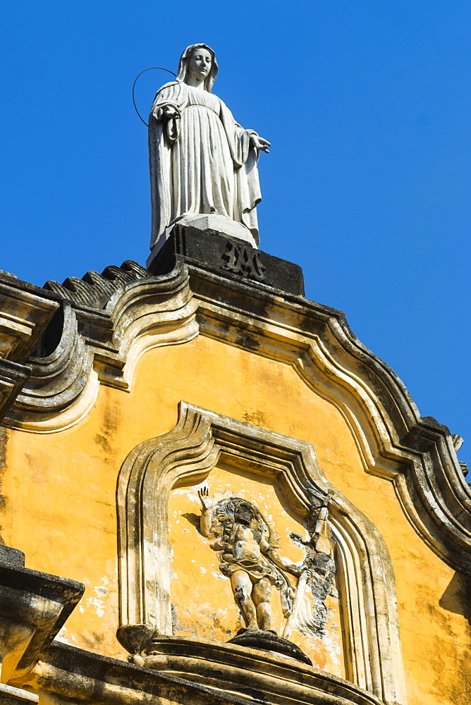 Statue atop the baroque facade of the Iglesia de la Recoleccion church, built 1786, in this historic northwest city, Leon, Nicaragua, Central America