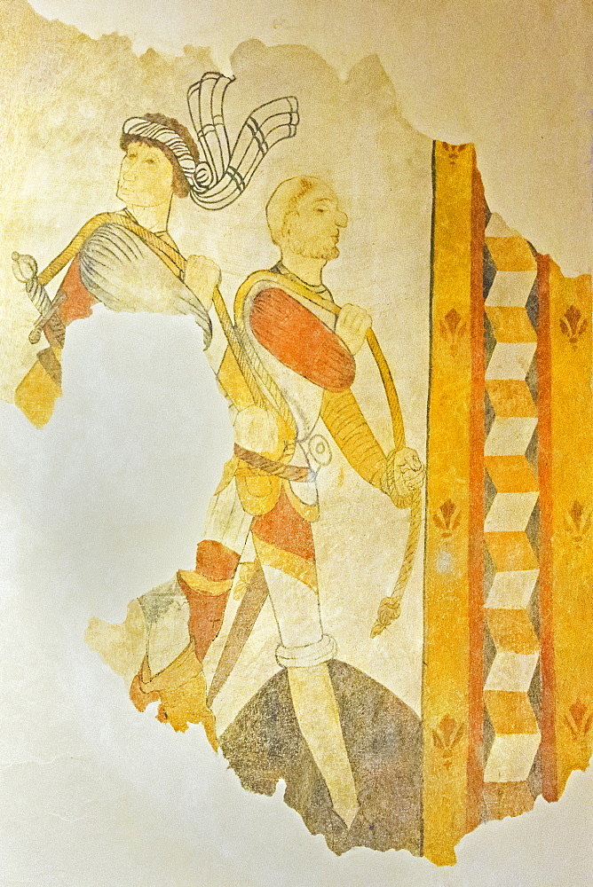 A 15th century fresco of armed men in St. Eutrope church in the historic village on the River Dropt, Allemans-du-Dropt, Lot-et-Garonne, France, Europe