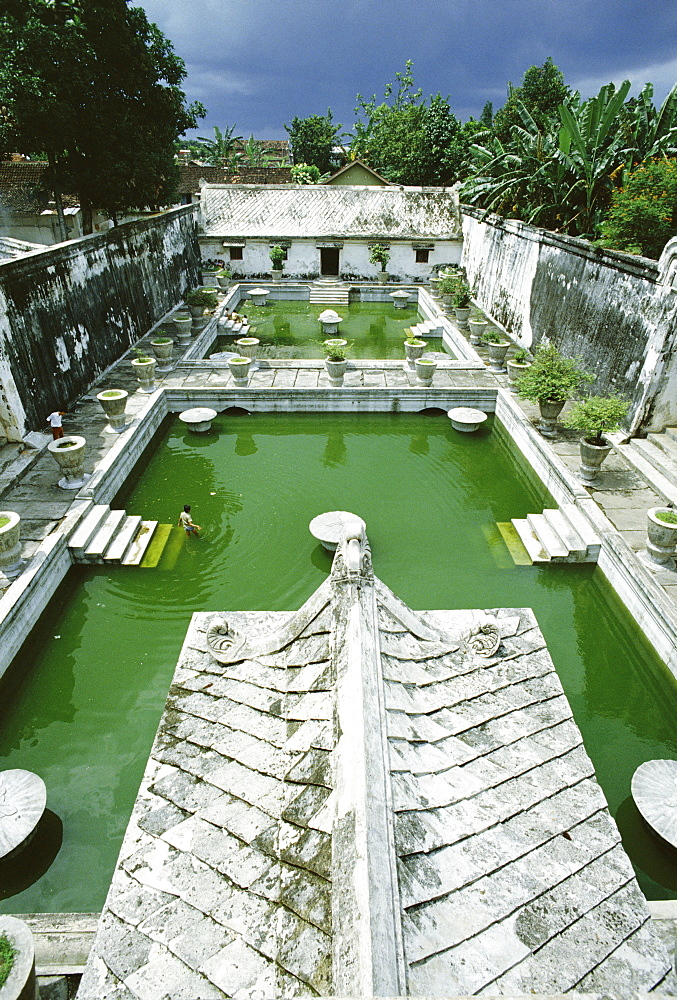 Swimming pools where the court princesses would bathe, at Taman Sari, the Water Castle, a vast pleasure palace built in 1761 by Sultan Hamengku Buwono I, Yogyakarta, Central Java, Indonesia, Asia