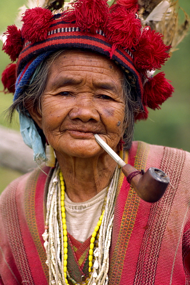 Portrait of an elderly woman of the Ifugao tribe wearing a woven hat decorated with feathers and carved bird at Banaue, Mountain Province, north Luzon, Philippines, Southeast Asia, Asia - 83-3944