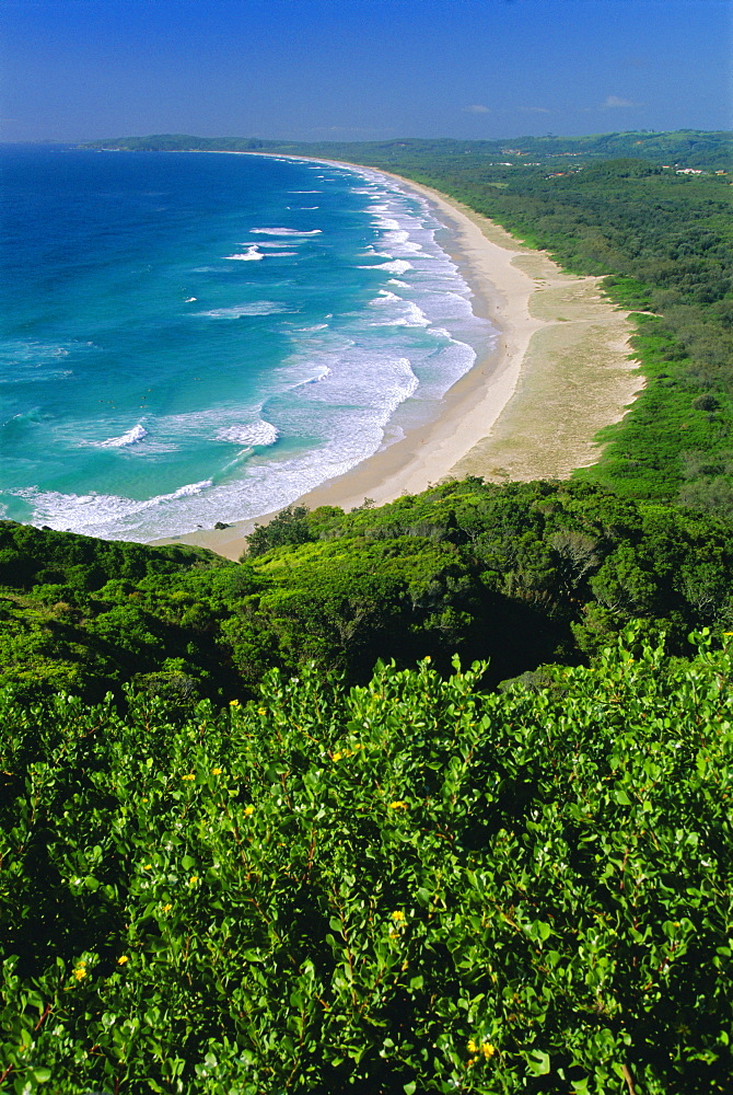 Tallow Beach from Cape Byron, a popular surfing spot east of the resort of Byron Bay in north east NSW, New South Wales, Australia