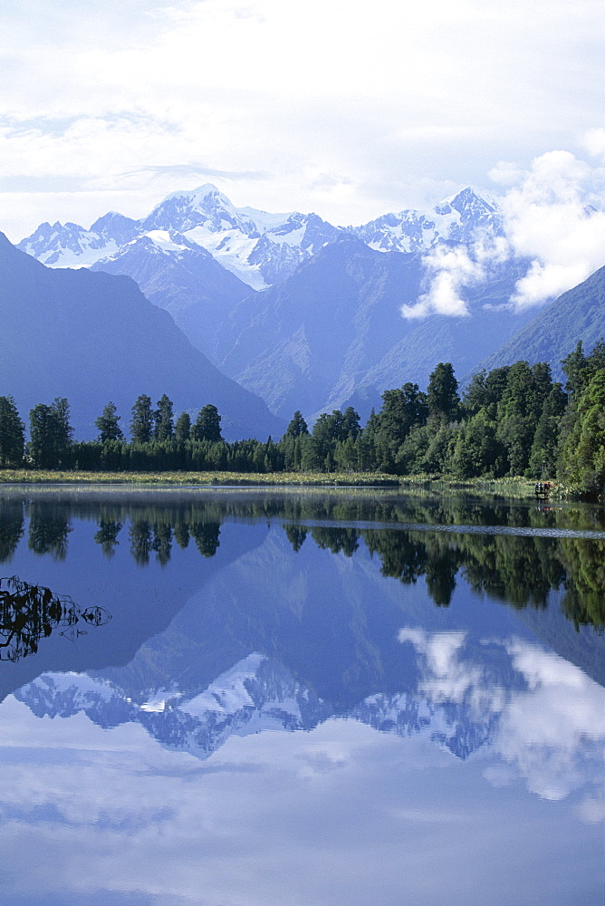 Mountains of the Southern Alps reflected in Lake Matheson, Canterbury, South Island, New Zealand, Pacific