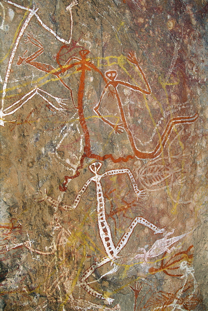 Dancing figures at Nourlangie Rock, aboriginal shelter and rock art site in Kakadu National Park, UNESCO World Heritage Site, Northern Territory, Australia, Pacific