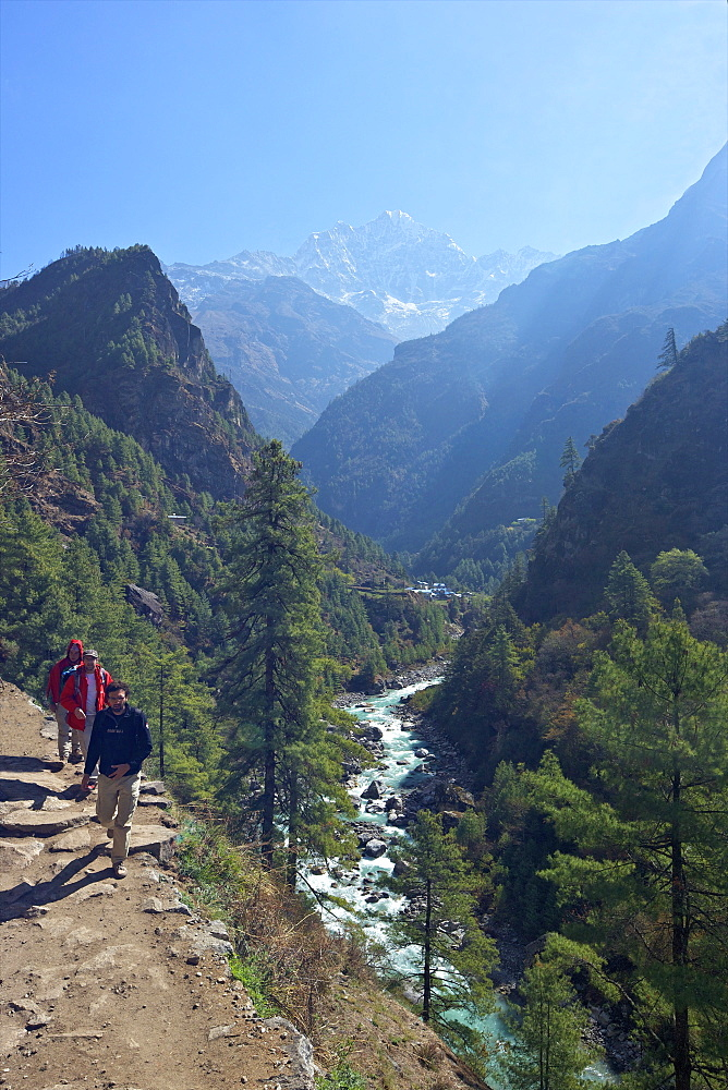 Trekkers on trail beside Dudh Koshi river, between Phakding and Namche, Chumoa, Everest Base Camp Trek, Solukhumbu, Nepal, Himalayas, Asia
