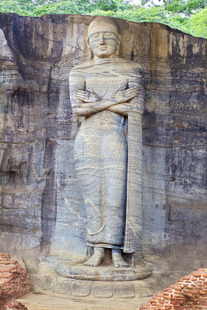 Buddha standing on lotus plinth in blessing posture, Gal Vihara Rock Temple, Polonnaruwa, Sri Lanka, Asia