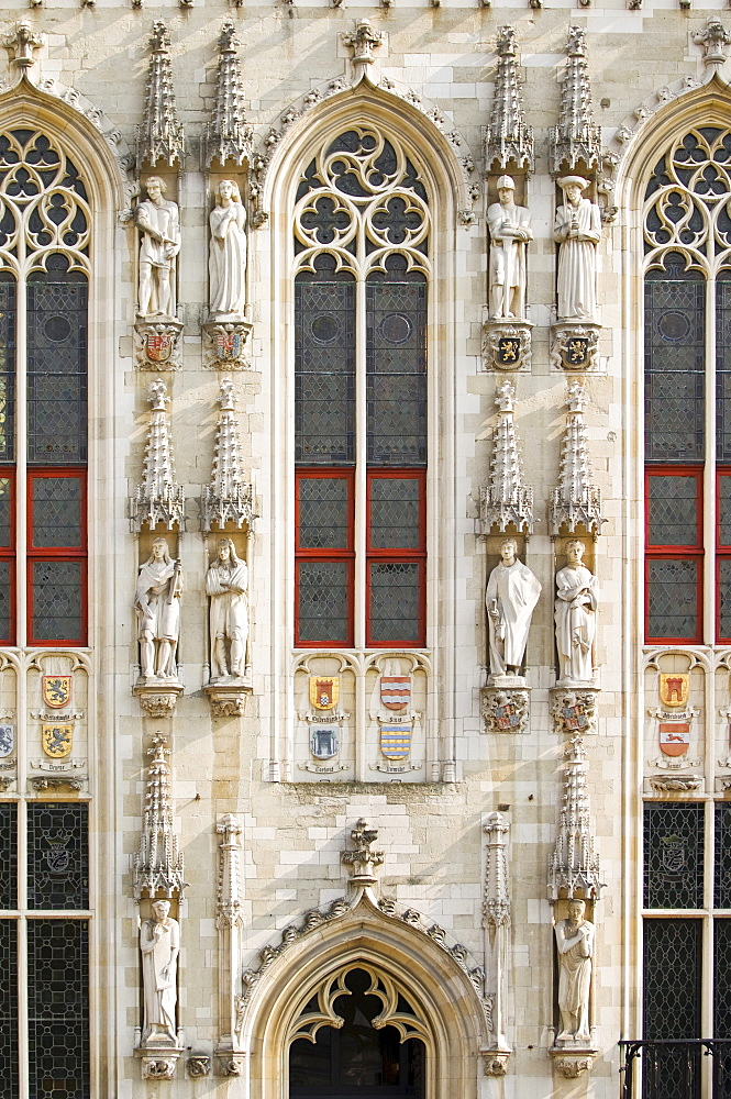 Detail of the facade of the city hall, historic centre of Bruges, Unesco World Heritage Site, Belgium, Europe