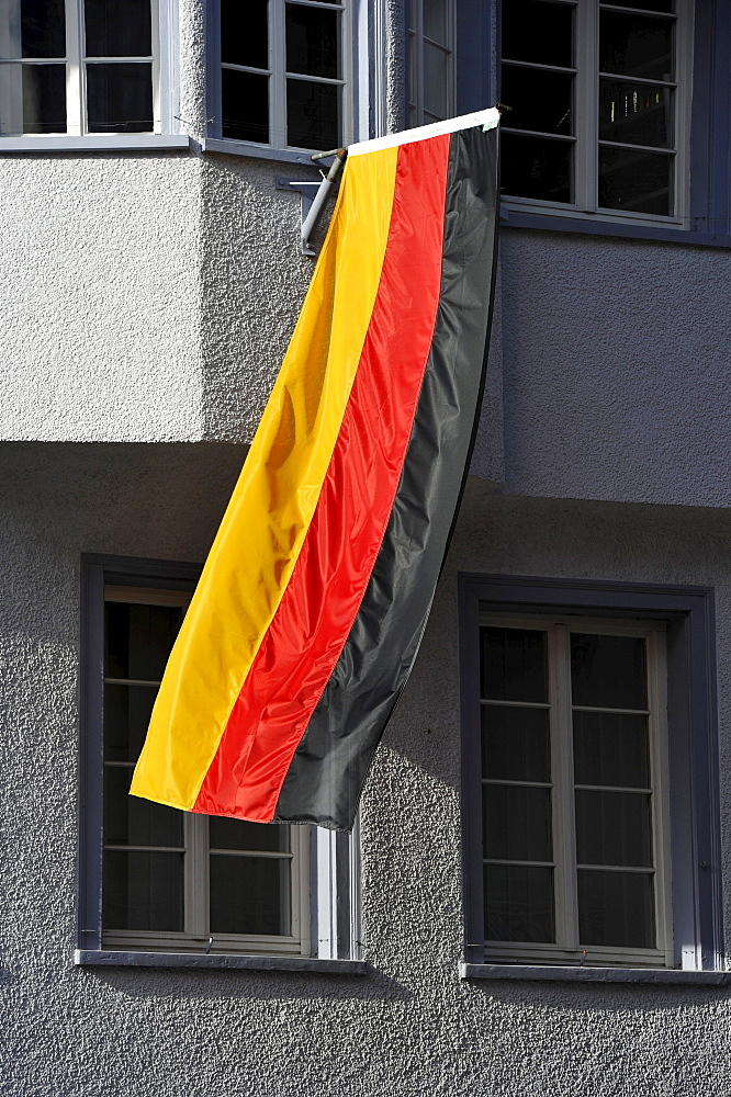 German flag hanging out of the window of a house during the 2010 FIFA World Cup