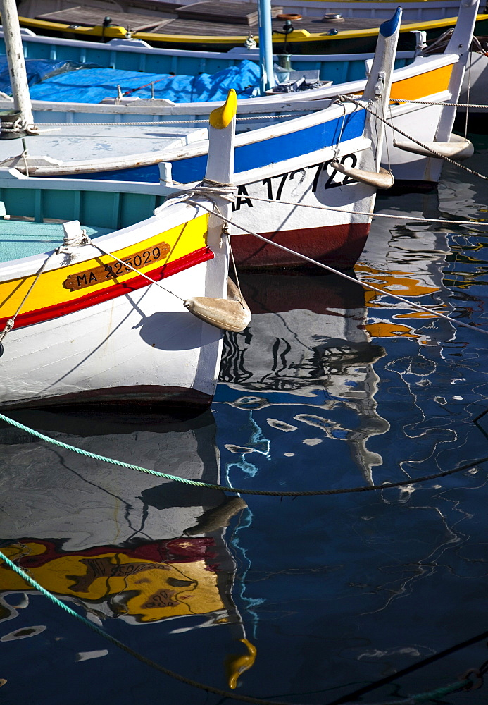 Boats and reflections in the Cassis Harbour, Provence, France, Europe