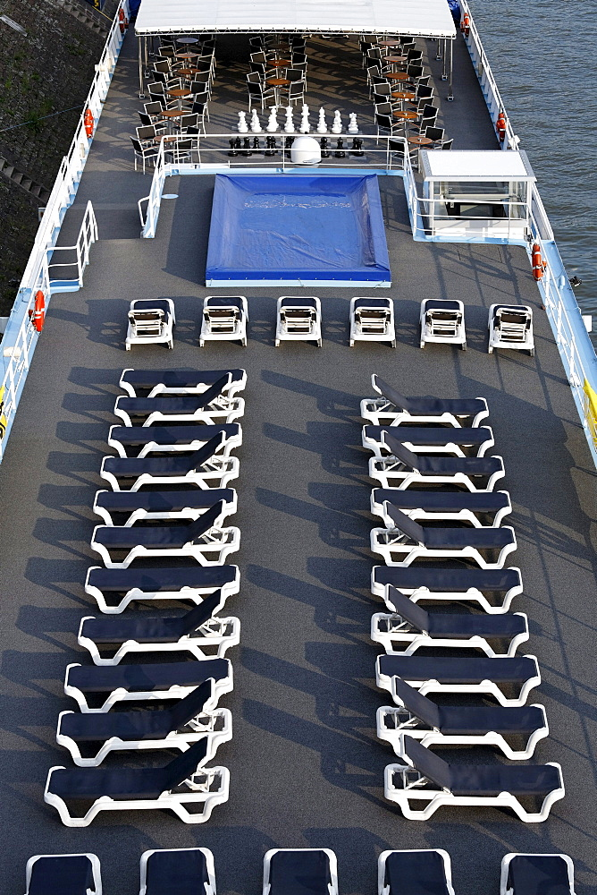 Two rows of aligned empty deckchairs on the deck of a cruise ship on the Rhine, Ruhrort, Duisburg, Ruhr Area, North Rhine-Westfalia, Germany, Europe