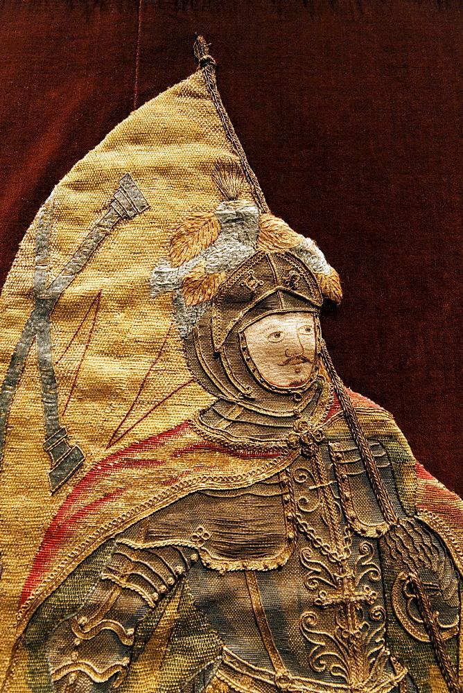 Knight in armor bearing flag, elaborate embroidery on a chasuble, historical liturgical garment, Stiftsmuseum Museum Xanten monastery museum, Xanten, Niederrhein region, North Rhine-Westphalia, Germany, Europe