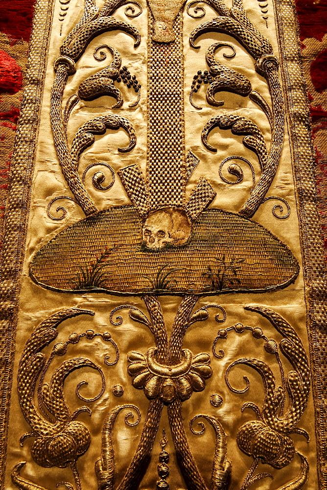 Baroque ornamentation with skull, artful embroidery on a chasuble, historical liturgical garment, Stiftsmuseum Museum Xanten monastery museum, Xanten, Niederrhein region, North Rhine-Westphalia, Germany, Europe