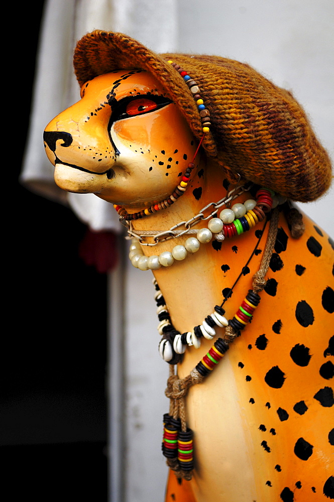 Decoration, figure of a Leopard with a knitted cap and jewelry in front of a fashion shop, Heidelberg, Baden-Wuerttemberg, Germany, Europe