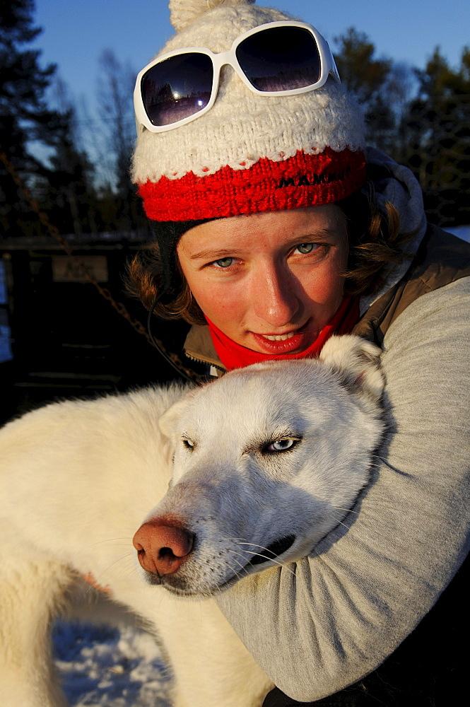 Woman with husky on a sledge dog-tour near Melkefoss, Finnmark, Lapland, Norway, Scandinavia, Europe