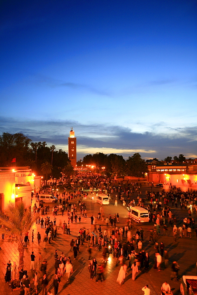 "Koutoubia Mosque illuminated with red light, Djemaa el-Fna ""Square of the Hanged Man"" in the medina quarter of Marrakech at dusk with its countless food stalls, Marrakech, Morocco, Africa"