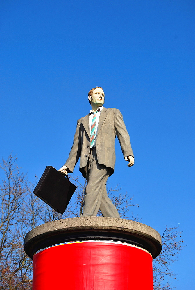 Businessman, sculpture on an advertising column, Duesseldorf, North Rhine-Westphalia, Germany, Europe