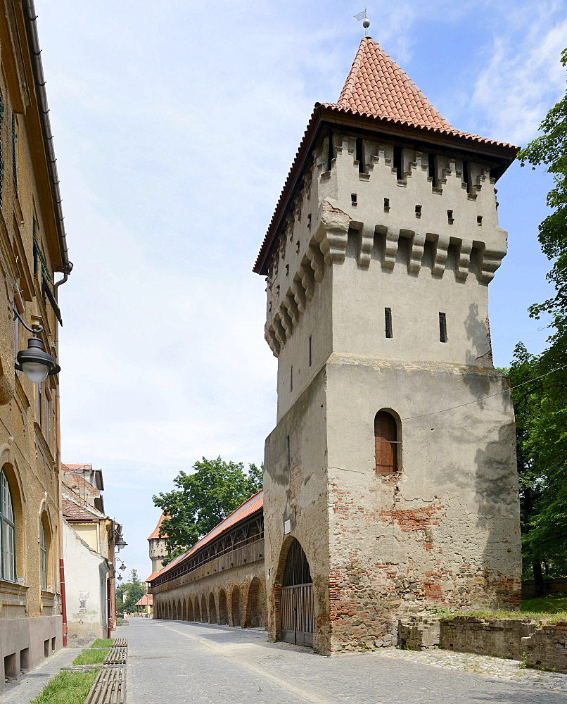 Defensive wall with tower in Strada Cetatii, Sibiu, Romania, Europe