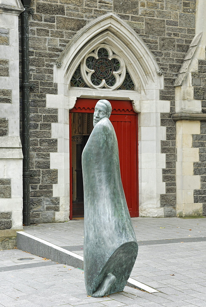 Bronze statue of a monk outside Christchurch Cathedral, Cathedral Square, Christchurch, South Island, New Zealand