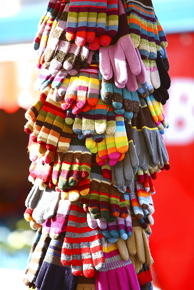 Winter gloves and mittens of different colors for sale on a market