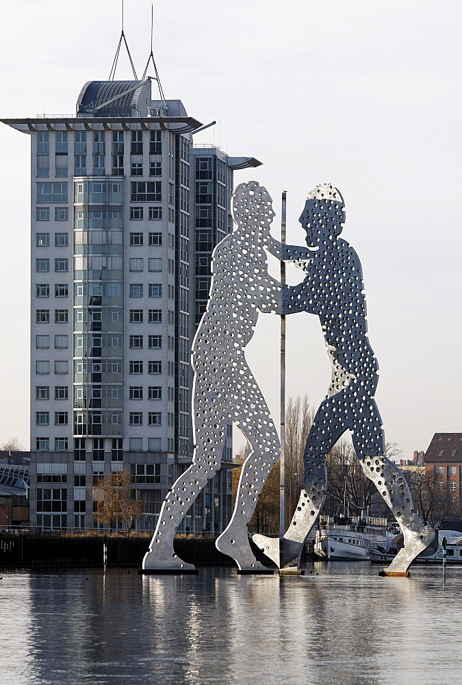 Molecule Man, monumental metal sculpture in the Spree river, Treptowers Allianz administration, Treptow district, Berlin, Germany, Europe