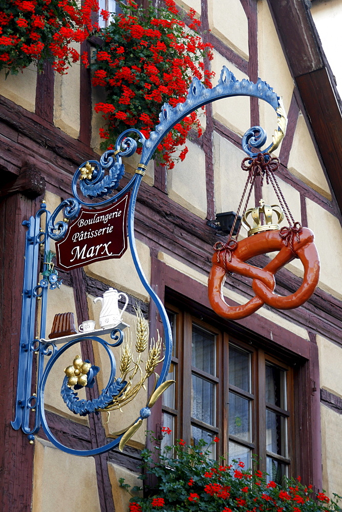 Bakery shop hanging-sign, Eguisheim, Alsace Wine Route, France, Europe