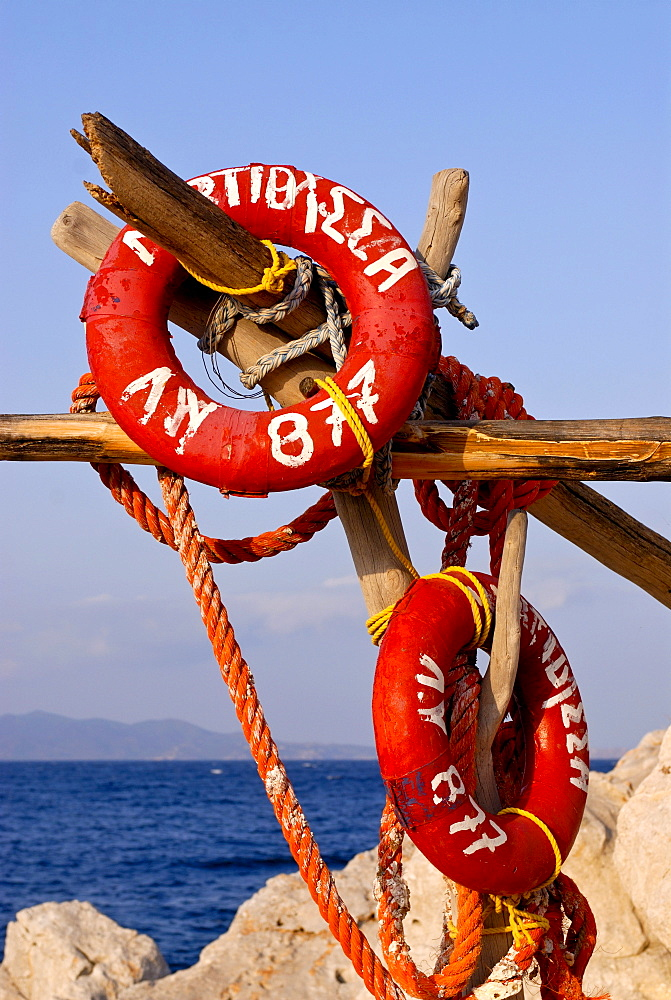 Life savers on a rack, port of Hydra, Hydra island, Greece, Europe
