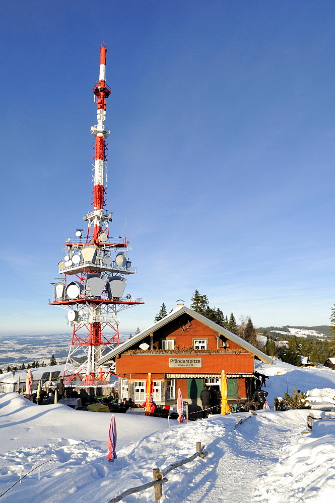 The 95 meter high transmission mast of the broadcaster ORF on the 1064 meter high Pfaender Peak with the guest house Pfaenderspitze, Vorarlberg, Austria, Europe