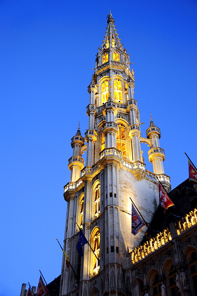 Town Hall with illumination in the evening, tower in a Gothic style, Stadhuis on Grote Markt or Hotel de Ville on Grand Place square, city centre, Brussels, Belgium, Benelux, Europe