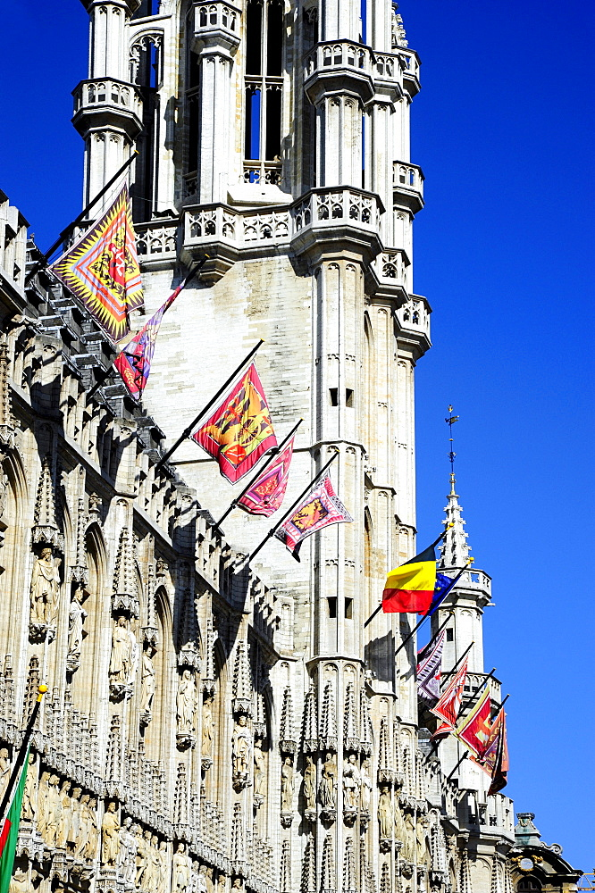 Town Hall with traditional flags and a tower in a Gothic style, Stadhuis on Grote Markt or Hotel de Ville on Grand Place square, city centre, Brussels, Belgium, Benelux, Europe