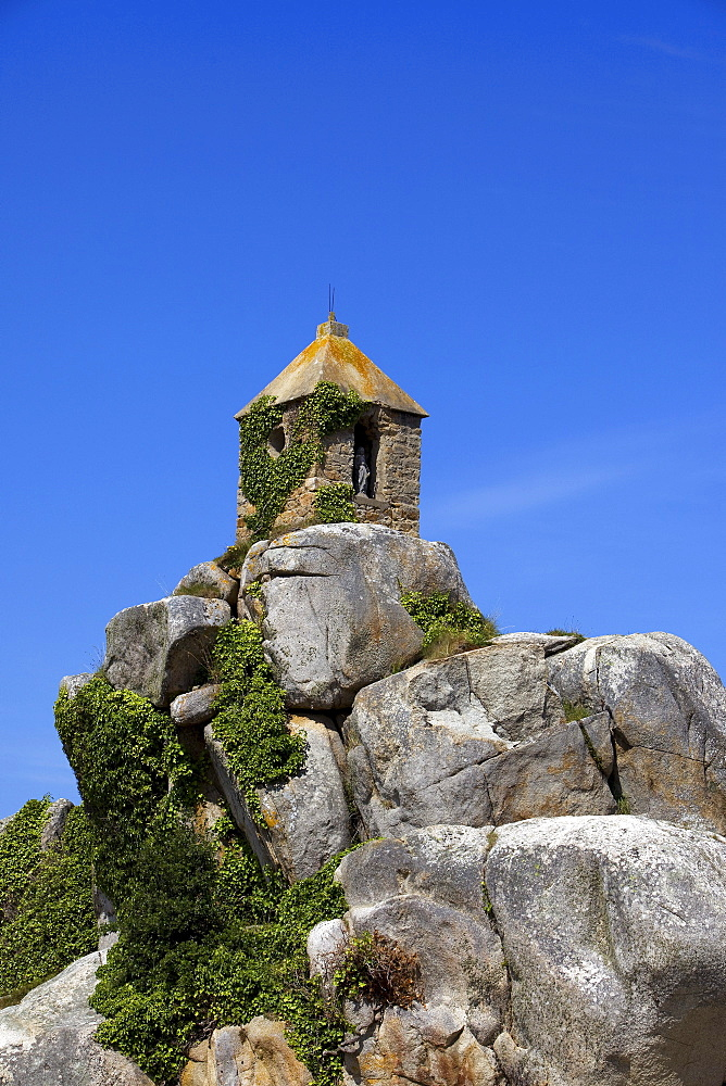Tower at Port Blanc on the Cote de Granit Rose, pink granite coast, Cotes d'Armor, Brittany, France, Europe
