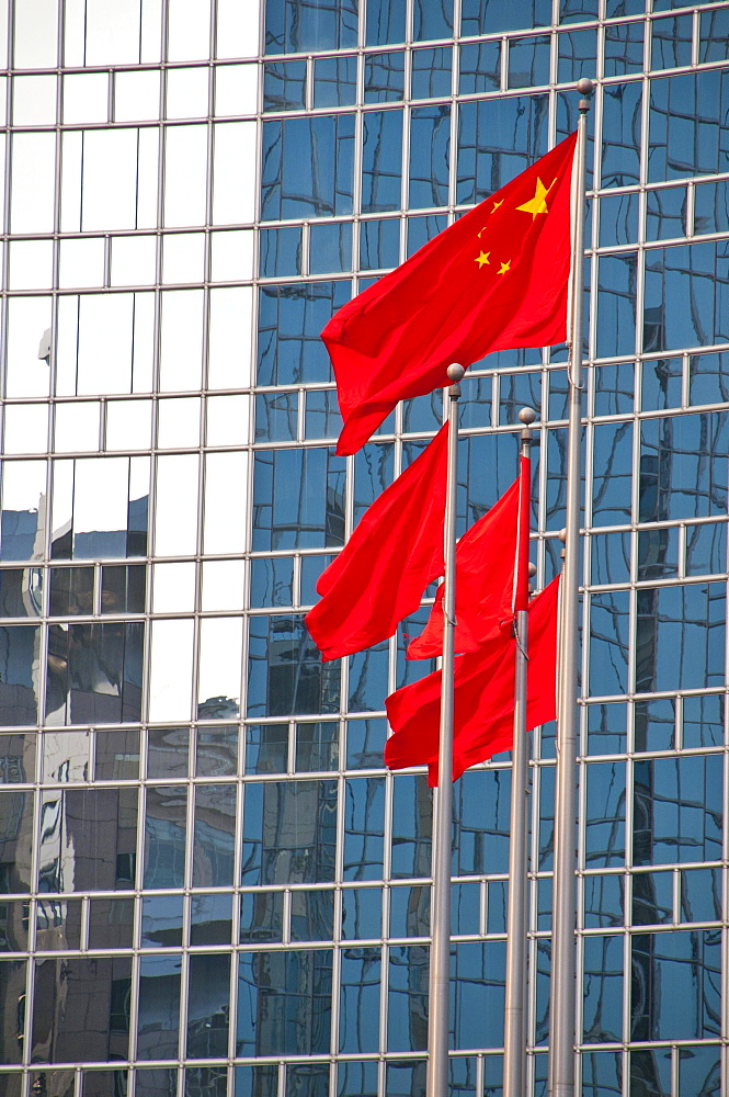 Chinese national flags in front of an office building in Beijing, China, Asia