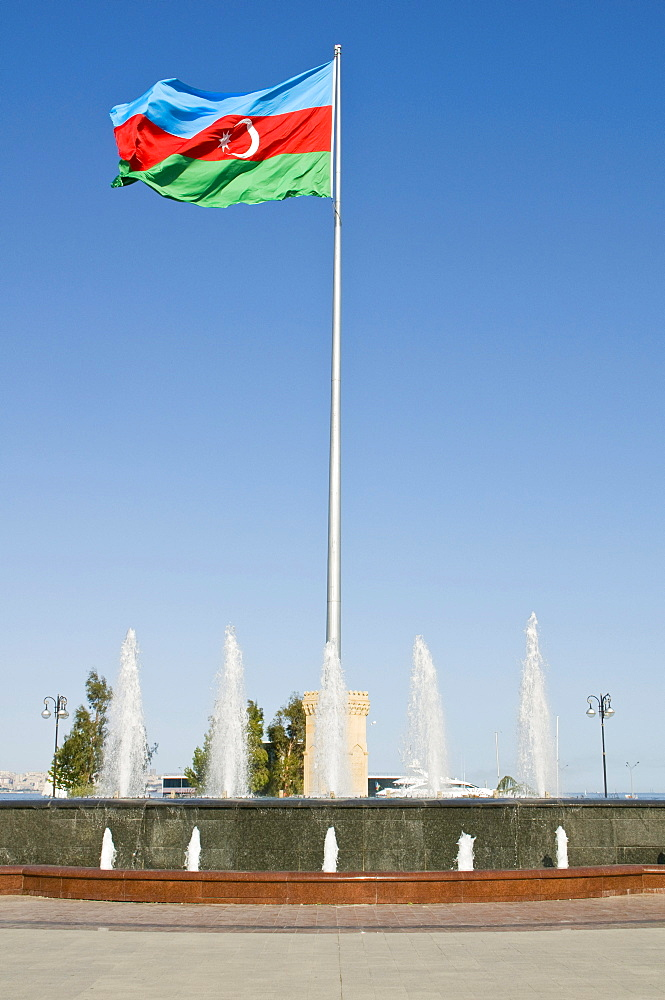 Azerbaijani flag in the wind in a park on the waterfront, Baku, Azerbaijan, Middle East