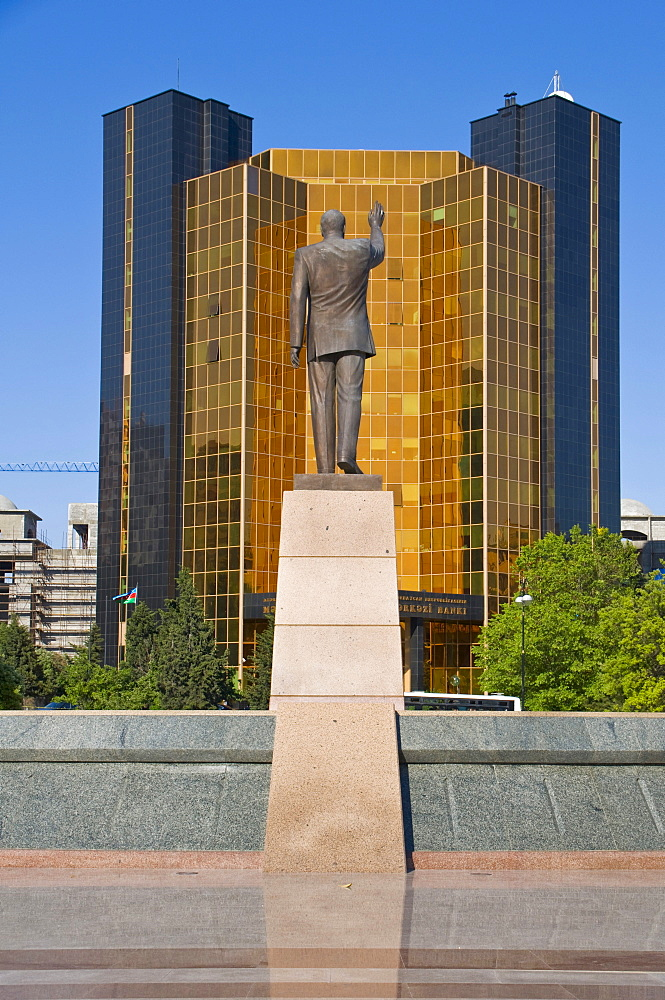 President statue in front of a modern high-rise building in Baku, Azerbaijan, Middle East