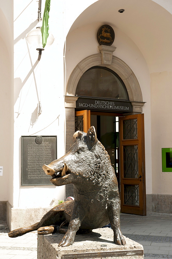 German Hunting and Fishing Museum in the former Augustinian church, sitting tusker at the entrance Keiler, Munich, Upper Bavaria, Bavaria, Germany, Europe