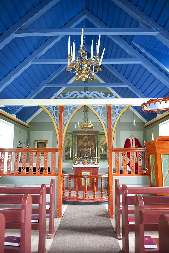 Colourful church interior, altar area, Lutheran church in the open-air museum Skogar, Iceland, Scandinavia, Northern Europe, Europe