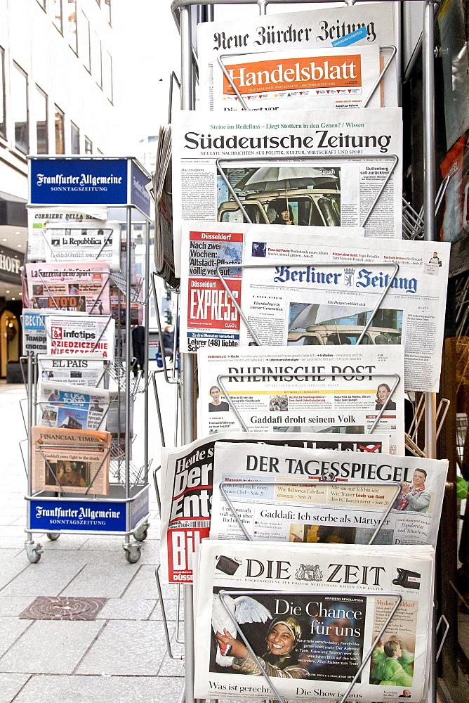 Newspaper rack with German and Swiss newspapers at a newspaper kiosk, Koenigsallee shopping promenade, short Koe, Duesseldorf, North Rhine-Westphalia, Germany, Europe