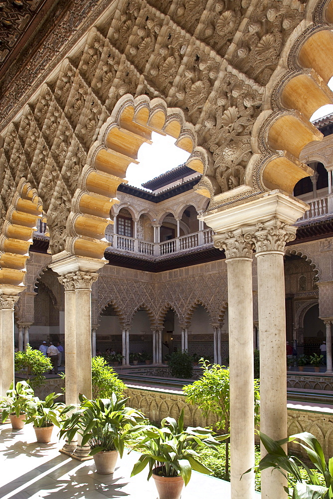Moorish ornamentation on the Patio de las Doncellas in the Moorish King's Palace of Real Alcazar, UNESCO World Heritage Site, Seville, Andalusia, Spain, Europe