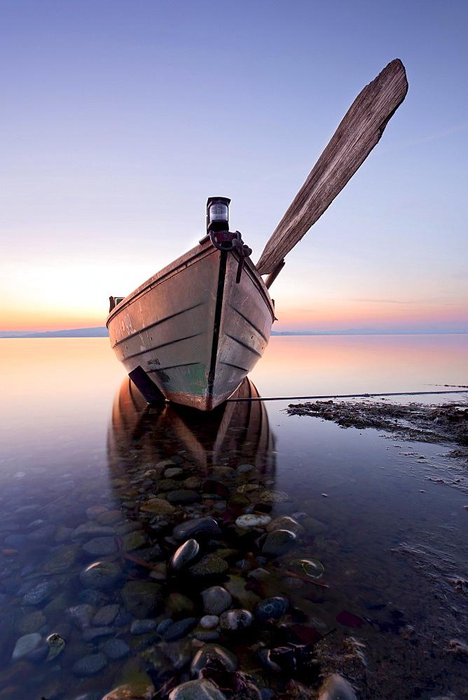 Evening with fishing boat on Reichenau island, Baden-Wuerttemberg, Germany, Europe