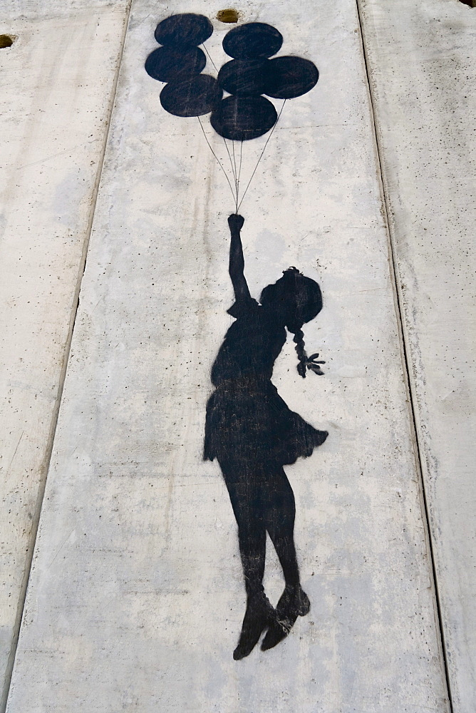 A banksy graffiti on the separation wall, Palestine, Middle East
