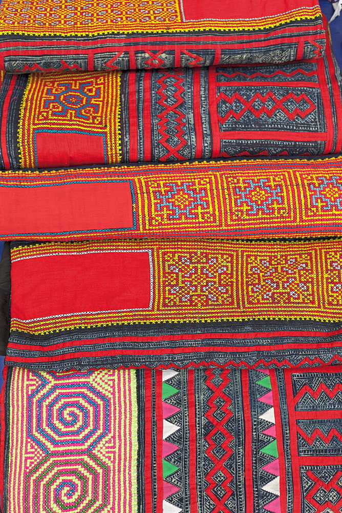 Colourful textiles on sale at the night market in Luang Prabang, Laos, Southeast Asia