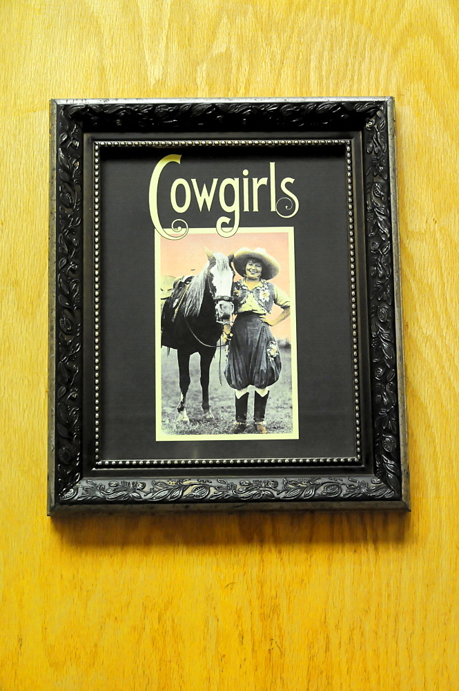"""Sign on a toilet door, lettering """"Cowgirls"""", Visitor Center, Grand Canyon, Arizona, USA, North America"""