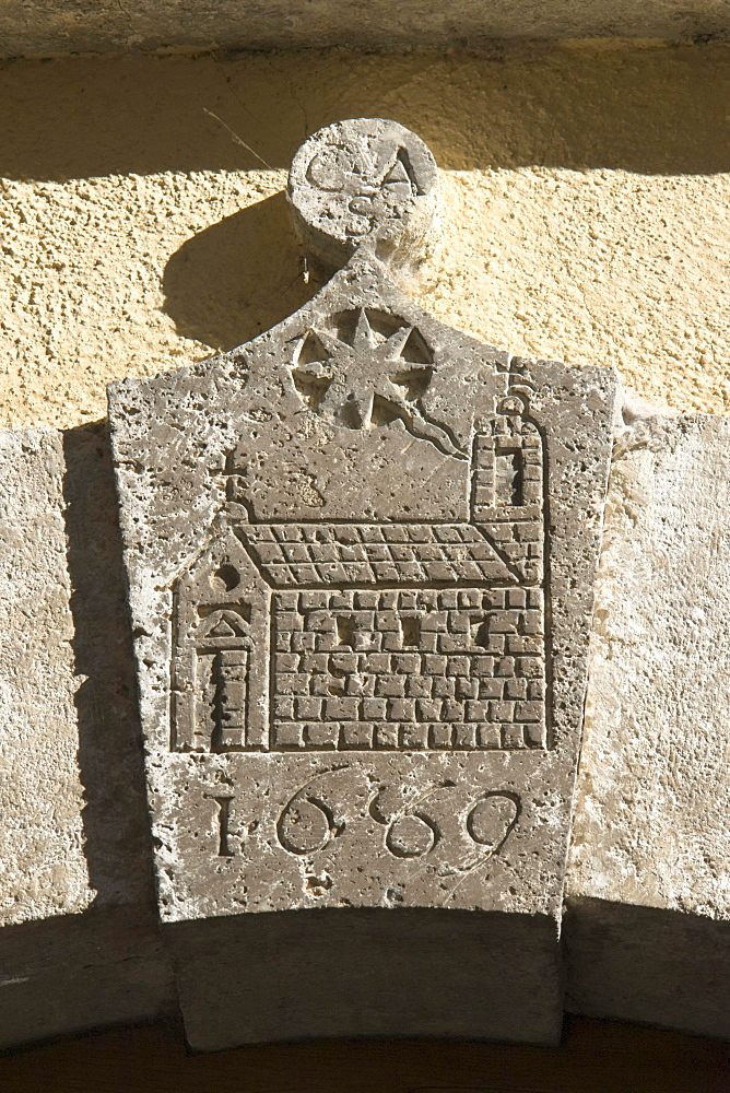 Ancient arch keystone decorated with the sketch of a church, a comet, the trigram CSA or CAS and the year 1669, Cittaducale, province of Rieti, Latium, Italy, Europe