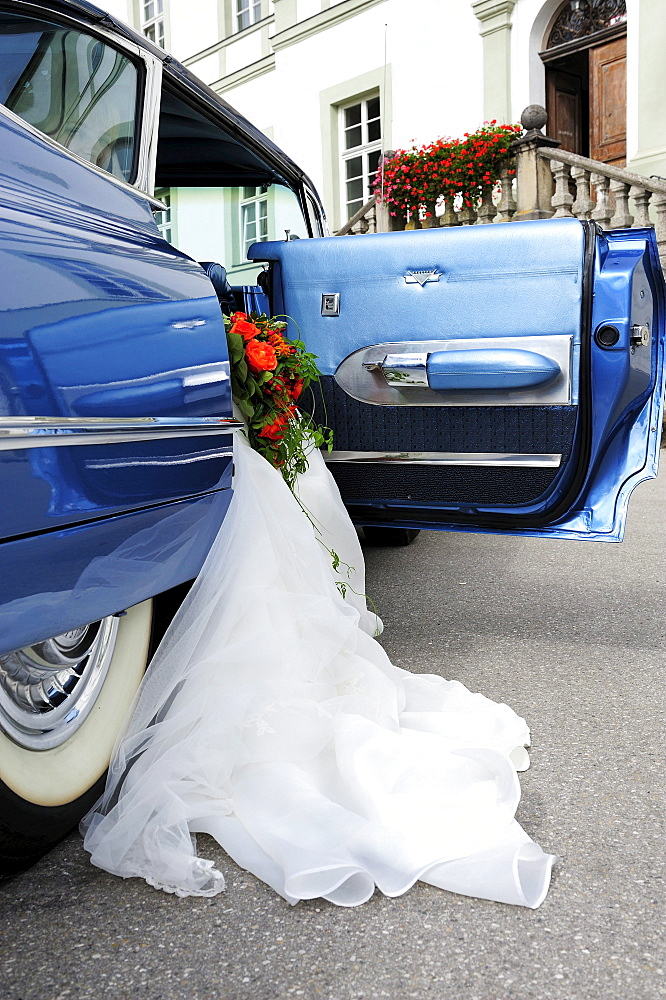 Wedding dress hanging out of a 1959 Chevrolet