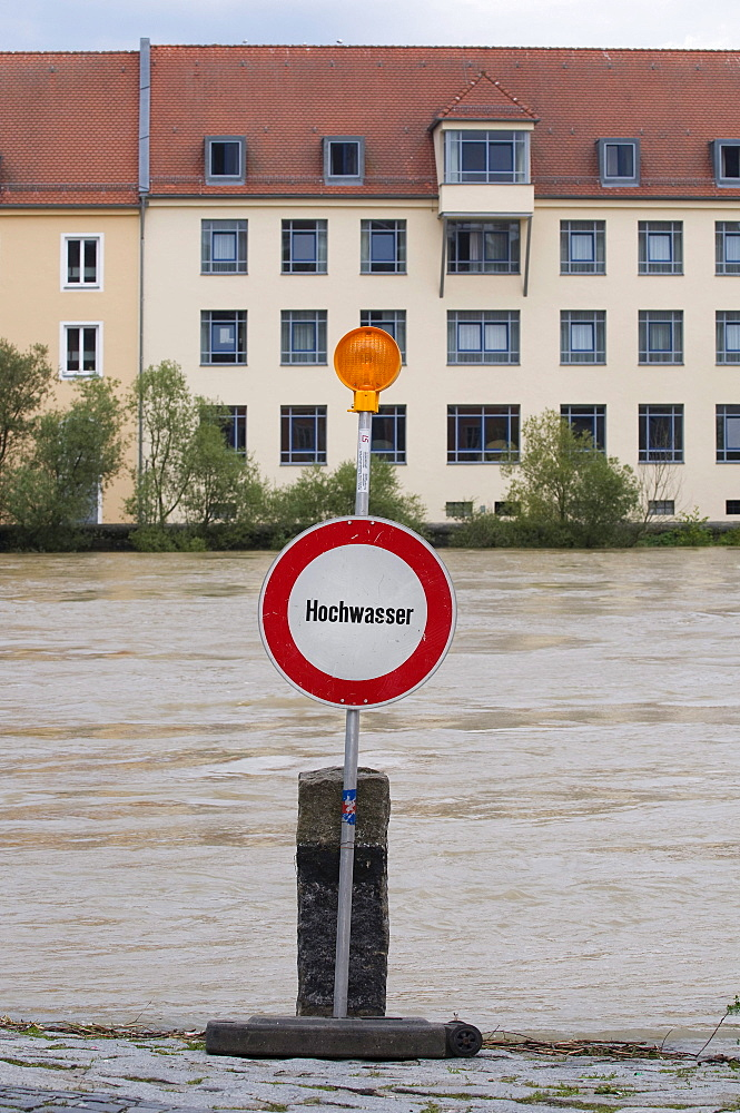 Sign with lamp in front of the river, floods on the Danube, Regensburg, Upper Palatinate, Bavaria, Germany, Europe