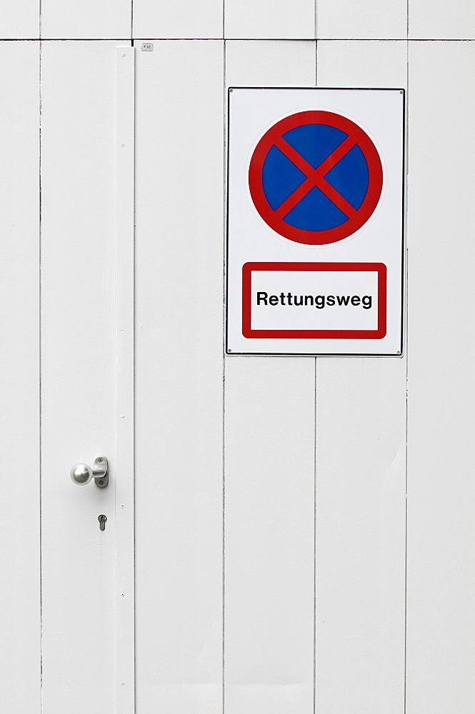 """No parking sign on an emergency exit, lettering """"Rettungsweg"""", German for """"escape route"""""""